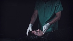 4K Crime Morgue Mortician Opens Black Bag with Dead Body Stock Footage