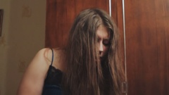 Long-haired girl falls to the floor Stock Footage