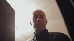 Portrait of a bald man on the background of illuminated lamps Stock Footage