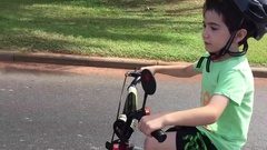 Young kid learn to ride bicycle Stock Footage