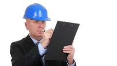Businessm Engineer With Black Suit and Helmet Take Notes Writing in a Clipboard. Stock Footage