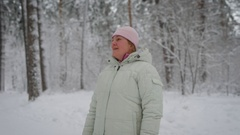 Adult woman with blonde hair, which are hidden under the pink hat, wearing a Stock Footage
