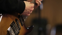 Hands of a Man Playing Vintage Looking Electric Guitar Stock Footage