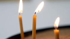 View of the three candles cutting through the darkness Stock Footage