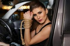 Sexy young woman with his hands tied Stock Photos