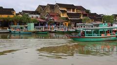 Vietnam, Hoi An -  Pleasure boat floats on Bon River in Hoi An Stock Footage
