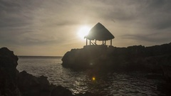 Jamaica: Thatch Hut with Clouds at Sunset Stock Footage