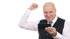 Enthusiastic Businessman Victory Hand Gestures Reading Good News on Tablet. Stock Footage