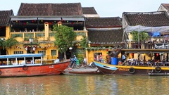 Vietnam, Hoi An - Tourists are on the quay of Bon River Stock Footage