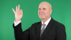 Satisfied Businessman Smiling Indicating Ok Sign Well Done Hand Gesture. Stock Footage