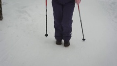 The elderly woman in the winter wood. The pensioner works the Finland walking Stock Footage