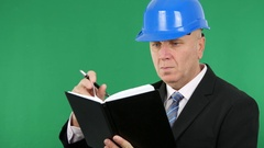 Technical Staff Confident Employee Wearing Black Suit Write in a Work Agenda. Stock Footage