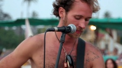 Unidentified man singing on the beach. Stock Footage