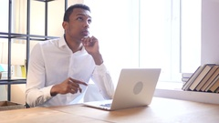 Black Man Thinking and Working on Laptop Arkistovideo