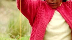 Woman spinning wool in Andes of Peru (South America) Stock Footage