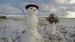 Snowman with Xmas tree in farm field, time lapse 4K Stock Footage