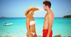 White millennial couple standing at the beach having a good time Stock Photos