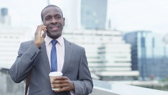 4K Portrait smiling London businessman talking on cell phone outdoors in the cit Stock Footage