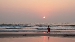 Beauty woman relaxing on the Goa beach in sunset rays Stock Footage