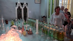 Girl is enjoying the perfume in the shop-museum 'Habana 1791'. Old Havana, Cuba Stock Footage