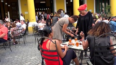 Latin Tourists in the open air restaurant at the Plaza Vieja. Old Havana, Cuba. Stock Footage