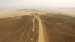 Car in Desert AERIAL: Car on earth road (South America) Stock Footage