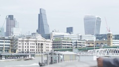 4K Successful London businessman standing beside River Thames looking out at vie Stock Footage