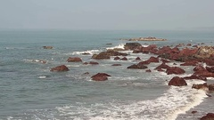 Beautiful seascape. Composition of nature – ocean waves and stones in water. Stock Footage