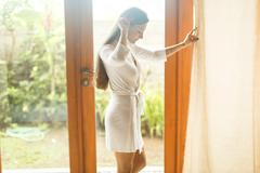 Young girl in white robe in hotel Stock Photos