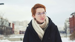 Portrait of flirting young woman with red hair Stock Footage