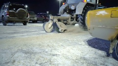 Special equipment cleans snow after a snowfall in the parking lot Stock Footage