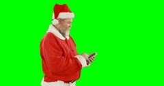 Santa claus using mobile phone Stock Footage