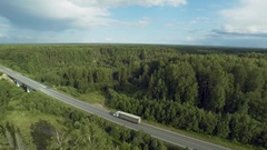 Truck drives in forest road asphult aerial view top Stock Footage