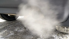 Toxic gases are exhausted on the tailpipe of a car, polluting the atmosphere. Stock Footage