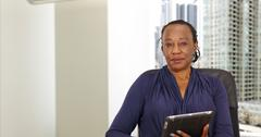 An African American businesswoman holding a tablet in her Chicago office Stock Photos
