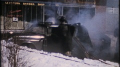 Firemen are too late to put out an automobile fire, 4011 vintage film home movie Stock Footage