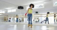 Adorable african american girl dancing in studio Stock Footage
