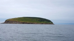 Beautiful cottage on rocky coast and island in Cape Breton Stock Footage