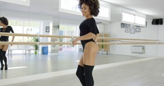 Sensual and sexy female dancer in black bodysuit Stock Footage