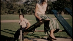 Women in the park on the teter totter and swings, 4018 vintage film home movie Stock Footage