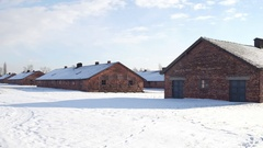 Steadicam shot of old concentration camp brick barracks in winter. 4K video Stock Footage