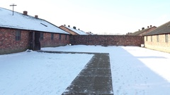 Pan shot of Auschwitz Birkenau barrack in winter. Former German Nazi Stock Footage