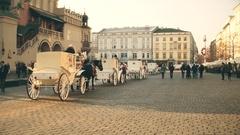 KRAKOW, POLAND - Steadicam shot of retro horse drawn carriages Stock Footage
