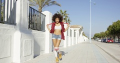Trendy young woman in skimpy denim shorts Stock Footage