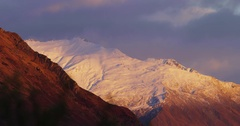 Red Snow Capped Mountains at Sunrise in New Zealand Stock Footage