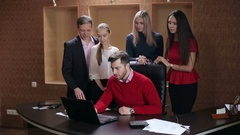 Happy business people celebrate success looking at laptop screen in the office. Stock Footage