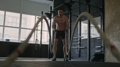 Man Doing Battle Rope Exercise Stock Footage