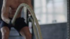 Man Cross-Training with Rope Stock Footage