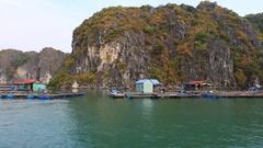 Floating fishing village in the Ha Long Bay. Cat Ba Island, Vietnam Stock Footage