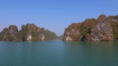 Rocky islands in the waters of the Ha Long Bay. Cat Ba Island, Vietnam Stock Footage